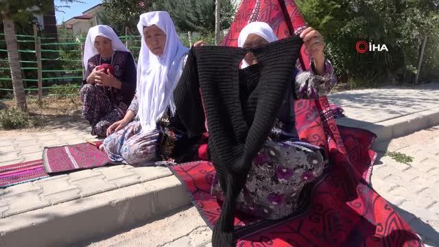 eski elbiselerden sökülen ipler, kırgız kadınlarının maharetli ellerinde halı ve kilime dönüşüyor 10